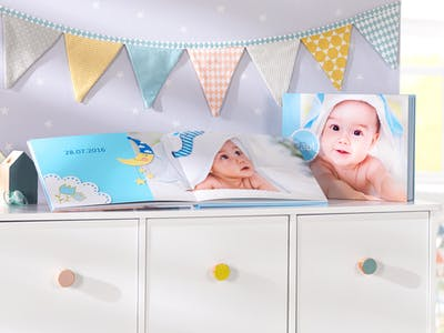 Profit from the Pixum's wide range of design options to make your baby photo book special.