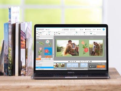 Fotobogen i tv�rformat - designet med fotounivers softwaren.