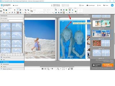 Pixum Fotobuch in der Fotowelt Software, in der die Fotos mithilfe von Hilfslinien korrekt ausgerichtet werden können.
