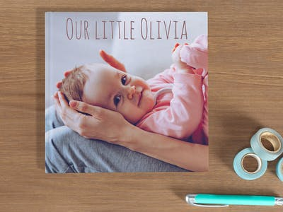 Design baby photo books in large or small, with matching binding, cover and paper type with Pixum.