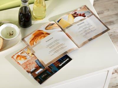 Voor elke gelegenheid het ideale cadeau: presenteer je lievelingsrecepten in een zelf ontworpen fotokookboek.