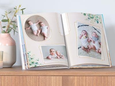 Pixum Fotobuch mit Babymotiven, gestaltet aus einer Vorlage der artboxOne.