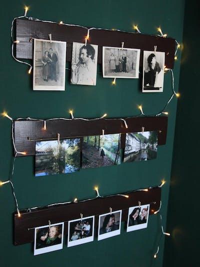 Holzleiste mit Fotoabzügen